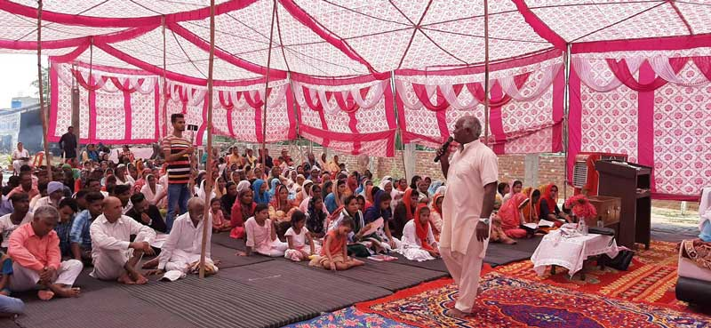 While the River of Life Church in Batala, India, is constructed, the congregation of 400 holds services under a gigantic tent.